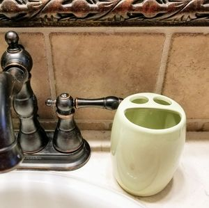 Toothbrush and toothpaste holder for bathroom